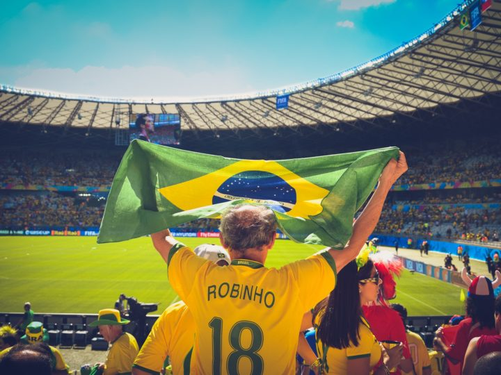 People are cheering for the Brazilian team